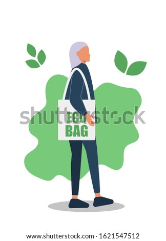 Young girl, young guy, with a bag of eco products. Eco-friendly food. Gender neutrality, unisex, gender neutral clothing, hairstyle. Young girl, young guy, pants and sneakers isolated on white