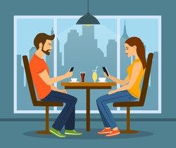 Young man and woman on a date in cafe busy with smartphones