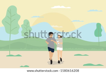 Young man and young woman running in the park.
