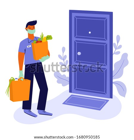 Young man, courier or volunteer in a medical mask and medical gloves delivers grocery products from the supermarket to the door to prevent the spread of the corona virus.
