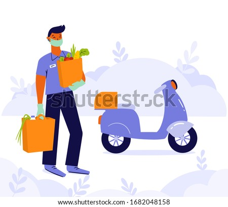 Young man, courier or volunteer in a medical mask and medical gloves delivers grocery products from the supermarket by motorbike. Non contact delivery to prevent the spread of the corona virus.