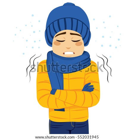 Young man freezing wearing winter clothes shivering Foto stock ©