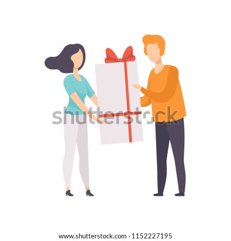 young man giving large gift box