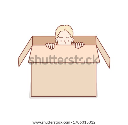 young man hiding in a carton