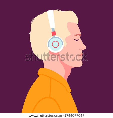 young man listen to music on