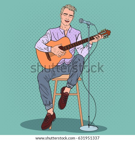 young man playing on guitar and