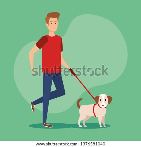 young man walking with dog
