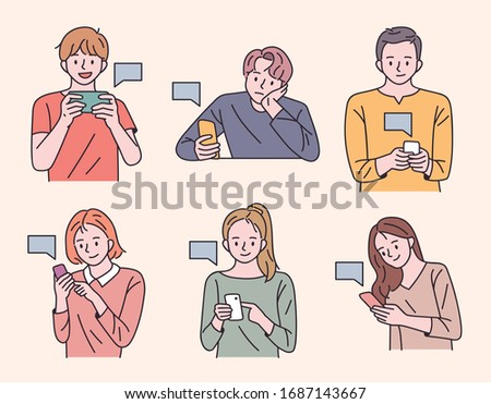 Young people are holding mobile phones and sending text messages. flat design style minimal vector illustration.