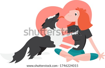 young redhead woman pet a dog