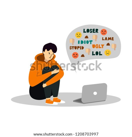Young teenage boy sitting in front of the laptop on white background. Cyber Bullying.