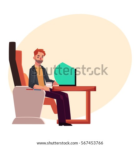 young unshaved man working on