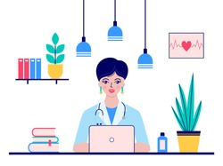 Young woman doctor sitting at the desk in doctor's office.Medical concept.