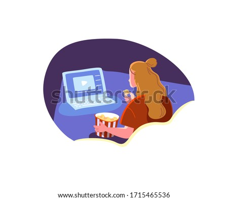 Young woman girl watching movie at home and eating popcorn. Stay at home. Young woman girl resting at home. Quarantine during Covid-19.