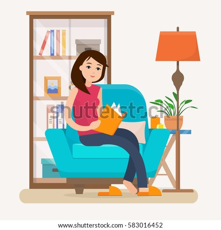 young woman reading book on