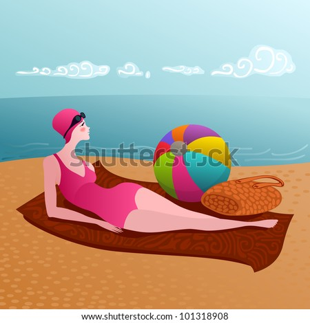 young woman relaxing on a sandy beach after a swim