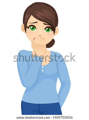 Young woman scared afraid and anxious biting her finger nails looking at camera with wide opened eyes isolated on white background
