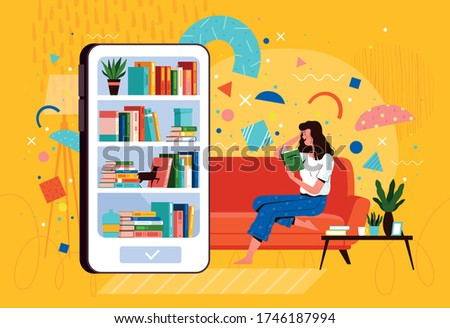 Young woman sits on a sofa and reads a book from a mobile library on the phone. E-book reader and distance learning concept Stockfoto ©