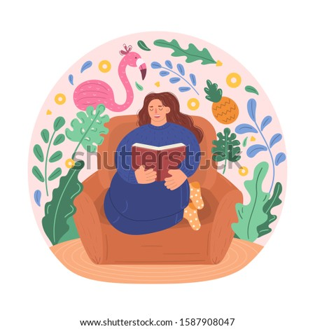 Young woman sitting at home on chair in of blue sweater and pants. Girl reading book, imagining tropical flamingos, pineapples, plants. Occupation in his free time, training, and leisure activities.