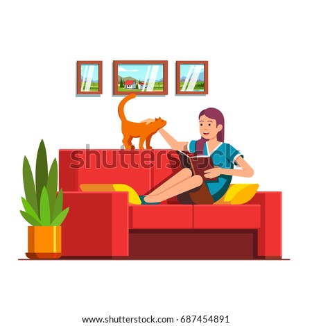 young woman sitting on red sofa