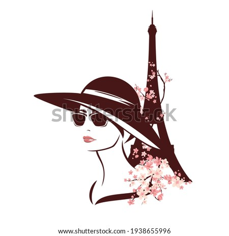 young woman wearing sunglasses and wide brimmed hat among blooming tree branches and eiffel tower - fashion spring in Paris vector design Photo stock ©