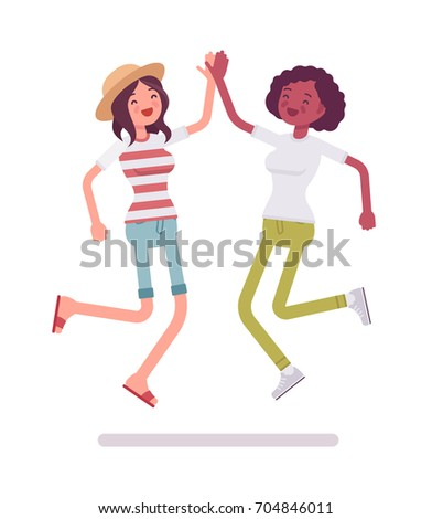 young women jumping giving high