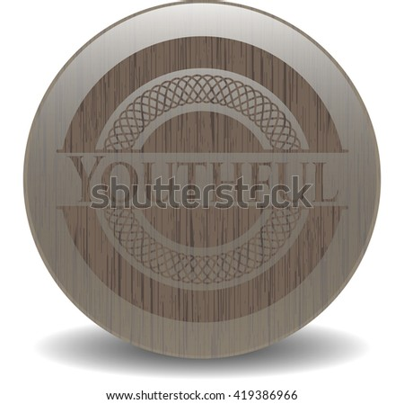 Youthful badge with wooden background