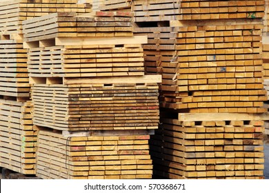 stock of wood planks on the factory yard