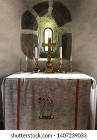Stockaryd, Smaland, Sweden - May 23 2019: The old altar in Hjalmseryds old church in Stockaryd with older parts from 12 th century