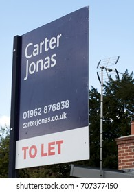 Stockbridge, Hampshire England - June 19, 2017: Carter Jonas estate agent sign advertising residential property to let