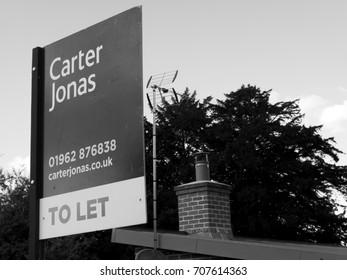Stockbridge, Hampshire England - June 19, 2017: Monochrome Carter Jonas estate agent sign advertising residential property to let