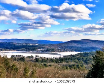 Stockbridge winter view from hill with blue sky and white clouds in massachusetts United States.