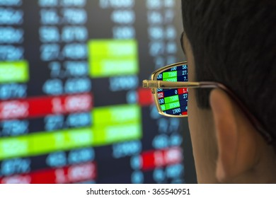 stockbroker at the screen with quotes