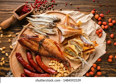 stockfish, dried fish, sea bass, sausages, salted breaded peanuts and red pepper for oktoberfest pub