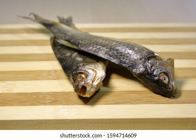 Stockfish on a wooden board on the table.