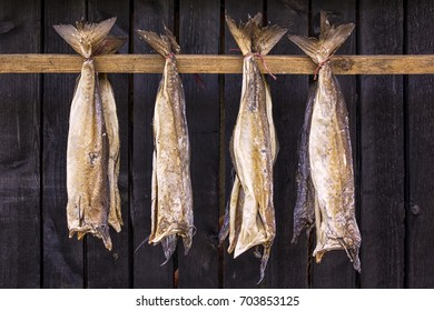 Stockfish is unsalted fish, especially cod, dried by cold air and wind on wooden racks, seen on the Faroe Islands.