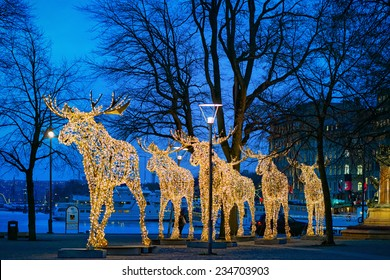 STOCKHOLM - 1 DEC: Group of Mooses made with light at Nybrokajen in Stockholm. 1 December 2014, Sweden. Christmas decoration or installation.