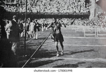 STOCKHOLM - 1912: Reproduction of old photography of runner Mac Arthur from South Africa winning marathon at Olympic Games in Stockholm, 1912