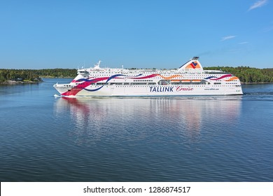 STOCKHOLM ARCHIPELAGO, SWEDEN - JUNE 1, 2018: Cruiseferry MS Baltic Queen of Tallink company goes along Skarpo island. The ship was built in 2007. She operates on the Tallinn-Mariehamn-Stockholm route