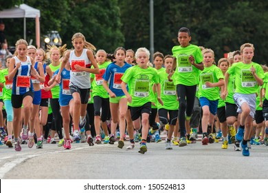 STOCKHOLM - AUG, 17: The children just after the start in the Midnight Run for children (Lilla Midnattsloppet) event, a group of excited children waiting. Aug 17, 2013 in Stockholm, Sweden
