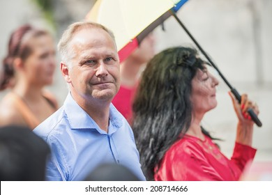 STOCKHOLM - AUG 2: Pride parade with the leader of the left wing party (vansterpartiet), Jonas Sjostedt. August 2, 2014 in Stockholm, Sweden.