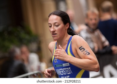 STOCKHOLM - AUG, 23:  World Triathlon  event Aug 23, 2014. woman running in Old town, Stockholm, Sweden. ÅSA ANNERSTEDT, SWEDEN..