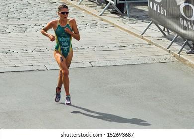 STOCKHOLM - AUG, 24: Natalie Van Coevorden (AUS) running the last lap in the Womens ITU World Triathlon Series event Aug 24, 2013 in Stockholm, Sweden