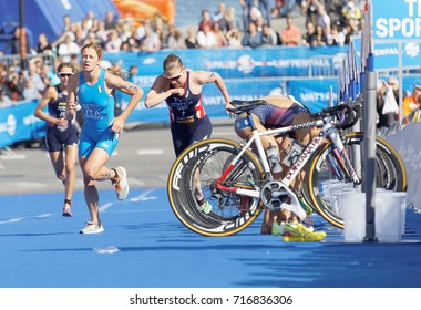 STOCKHOLM - AUG 26, 2017: Female triathlete Betto and Stimpson change from cycle to run running in the transition zone in the Women's ITU World Triathlon series event August 26, 2017,Stockholm,Sweden