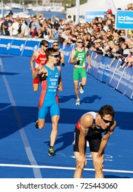 STOCKHOLM - AUG 26, 2017: Fighting and running triathletes Gundersen, Knabl, White and others at the finish in the Men's ITU World Triathlon series event August 26, 2017 in Stockholm, Sweden