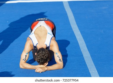 STOCKHOLM - AUG 26, 2017: French triathlete Dorian Coninx (FRA) laying down exhausted after the race in the Men's ITU World Triathlon series event August 26, 2017 in Stockholm, Sweden