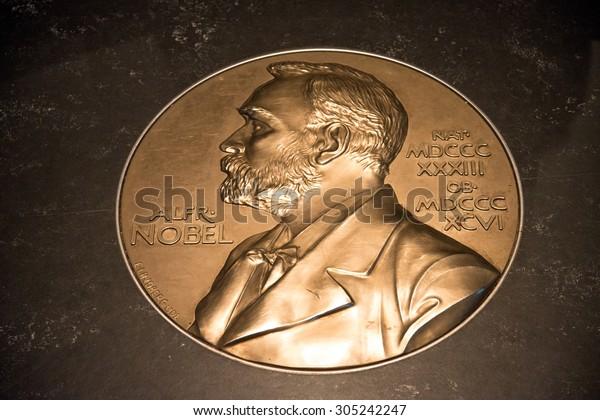 STOCKHOLM - CIRCA JULY 2015: Swedish Academy on Stortorget square.. Portrait of Alfred Nobel.