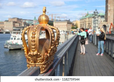 Stockholm city in Sweden. Decorative crown sculpture on Skeppsholmsbron bridge.