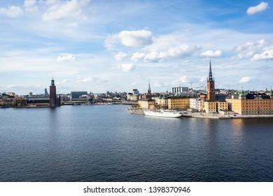Stockholm city, Sweden. Riddarholmen - historical part of the  Old Town in Stockholm. View of Stockholm Townhall ( Stadshus ) seen from Monteliusvägen viewing platform.