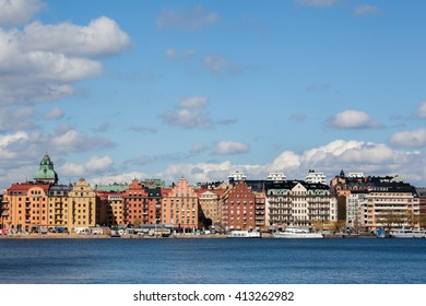Stockholm city under a clear spring sky with clouds.