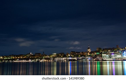 Stockholm cityscape at night with light reflection in water